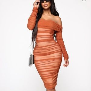 Ready in a runched off shoulder mid dress